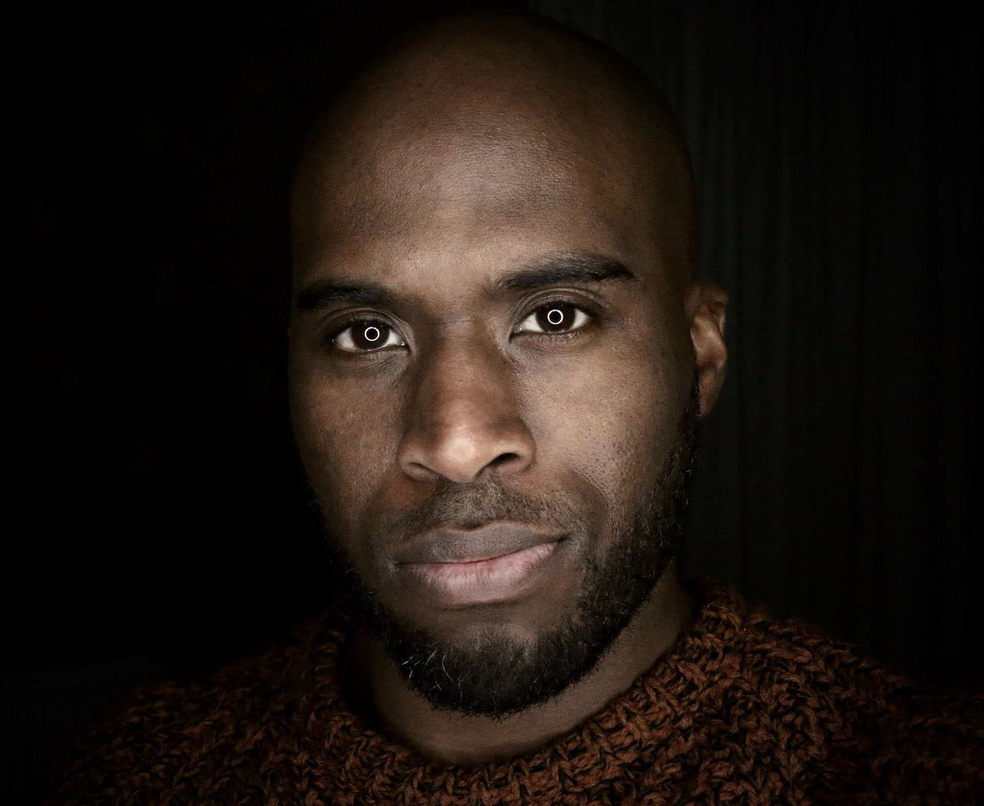 Image of black men with ring light